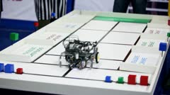Referee watch on robot moves, collects cubes and put them to different places Stock Footage
