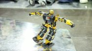 Stock Video Footage of Toy robot dance on metal surface