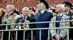 Many veterans stand on Red square near kremlin wall and Spasskaya tower Stock Footage