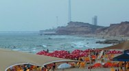 Stock Video Footage of 138 RED PARASOLS AT THE BEACH