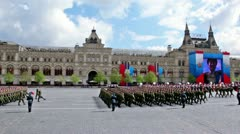 Soldiers ranks march with guns on Red square on Victory Parade Stock Footage