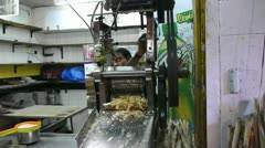 Making sugarcane juice Stock Footage