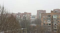 Winter. Snow falls on the background of houses Stock Footage