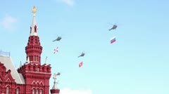 Five helicopters with flags fly over spire of State Historical Museum on Red Stock Footage