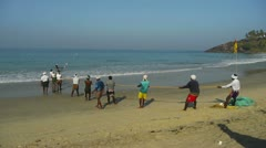 Fishermen pulling a trawl Stock Footage