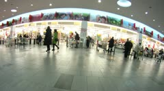 People pay for made purchases and leave shopping center AshanTroika Stock Footage