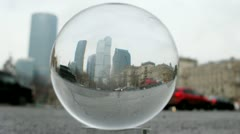 Business center Moscow City is visible through transparent glass ball Stock Footage