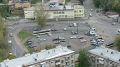Old tram stands near to old houses and parking Stock Footage