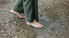 Barefoot in poodle - stock footage