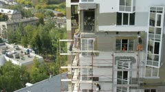 Workers build the house which stands in front of park Stock Footage