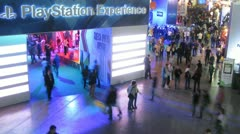People walk in pavilion of SONY at an exhibition of Igromir in business centre Stock Footage