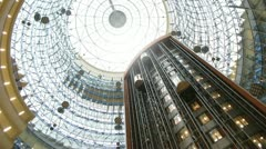 Stock Video Footage of Lifts move downwards and upwards under glass calotte of tower