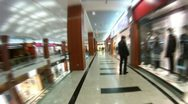 Buyers walk and visit shops of shopping center Stock Footage
