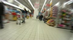 People walk and are engaged in purchases in shopping centre - stock footage