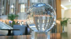 In glass ball is reflected business center hall Stock Footage