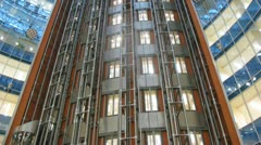 Many lifts move downwards and upwards  in business center Stock Footage