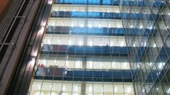 In windows of business center is shone light on stages indoors Stock Footage
