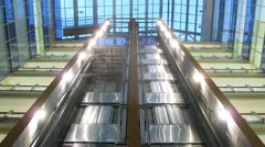 Two elevators go to business-center where light in windows of offices is shone - stock footage
