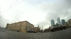 Flow of cars goes on Kutuzovsky prospectus in front of business center Moscow Stock Footage