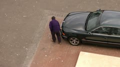 Man cleaning car Stock Footage