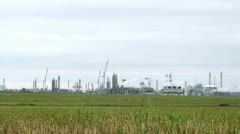 Phosphoric factory stands far against blue sky Stock Footage