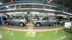 Workers do car complete set in assembly shop - stock footage