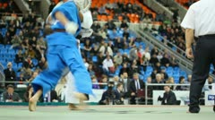 Sportsmen Zivic from Russia in dark blue and Mirco in white kimono fight Stock Footage