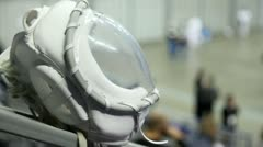 White helmet of fighter KUDO against sportsmen training in hall Stock Footage