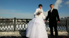 Newly-married couple is turned together on bridge Stock Footage