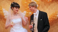 Newly-married couple dances and sings together holding in hands glasses Stock Footage