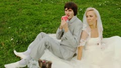 Groom inflates red air sphere-heart and gives to bride Stock Footage