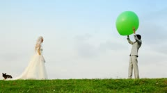 Newly married play meadow with each other inflatable sphere Stock Footage