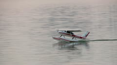 Radio controlled water airplane taxing 1/8 Stock Footage