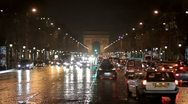 Stock Video Footage of Champs Elysees at night with views of the triumphal arch