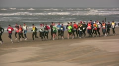 Running contest on the beach, marathon along the sea shore, Holland, Netherlands Stock Footage