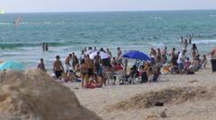 074 PEOPLE IN CAESAREA BEACH Stock Footage