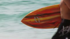 070 MAN WITH SURFBOARD CAES Stock Footage