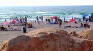 Stock Video Footage of 069 PEOPLE IN CAESAREA BEACH, ISRAEL