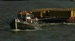 Stock Video Footage of Tugboat Hauling Cargo on The Thames River