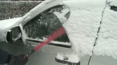 Cleaning snow off car 01 Stock Footage