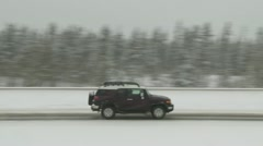SUV on winter highway - stock footage