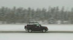 SUV on winter highway Stock Footage