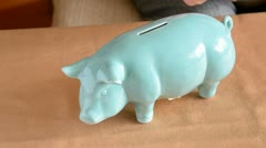 put money in the piggy-bank - stock footage