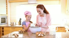 Mother and daughter cooking - stock footage