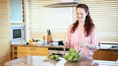 Young woman mixing a salad Stock Footage