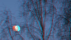 Stereoscopic 3D of moon rising behind the trees 1 combo Stock Footage