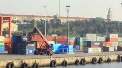 Mobile crane runs at sea port warehouse Stock Footage