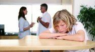 Sad child listening to his parents quarreling Stock Footage