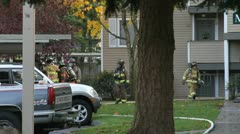 Firefighter Getting Hosed-Off (Rinsed) Stock Footage