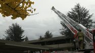 Firefighter Atop Ladder Stock Footage
